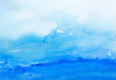 Close up de trazos de color de agua pintando sobre fondo blanco  Foto de archivo