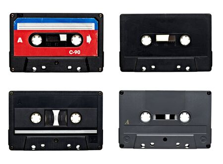 collection of old audio tapes on white background. each one is in full camera resolution photo