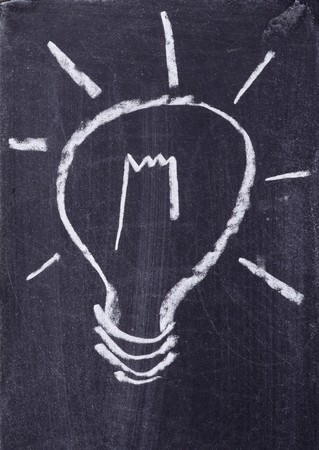 close up of a light bulb drawing on blackboard Stock Photo - 7969047