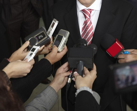 public speaking: close up of conference meeting microphones and businessman