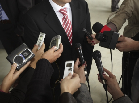 press media: close up of conference meeting microphones and businessman