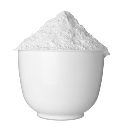 close up of  a white bowl and baking powder on white background   photo