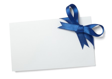 blue ribbon: close up of  card note with blue ribbon