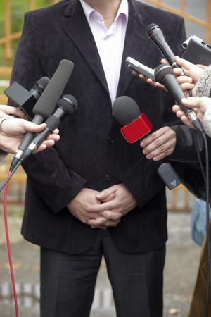 close up of conference meeting microphones and businessman Stock Photo - 8102691