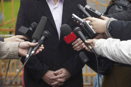 close up of conference meeting microphones and businessman Stock Photo - 8102703