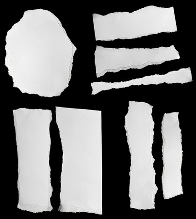 collection of  white ripped pieces of paper on black Stock Photo - 8102819
