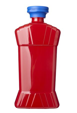 squirting ketchup: close up of  ketchup bottle on white background  with clipping path