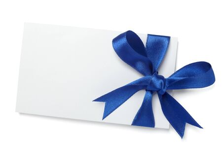 gift wrapping: close up of  card note with blue ribbon on white background  with clipping path Stock Photo