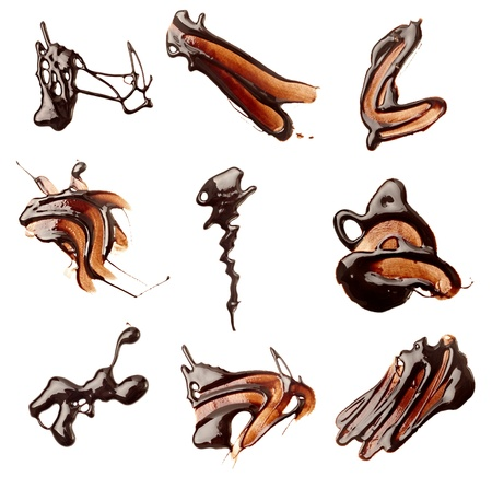 syrupy: collection of chocolate syrup stains and chocolate pieces on white background. each one is shot separately