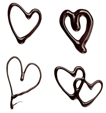 fudge: collection of  chocolate syrup heart shapes on white background. each one is shot separately