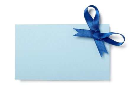 close up of  card note with blue ribbon on white background   photo