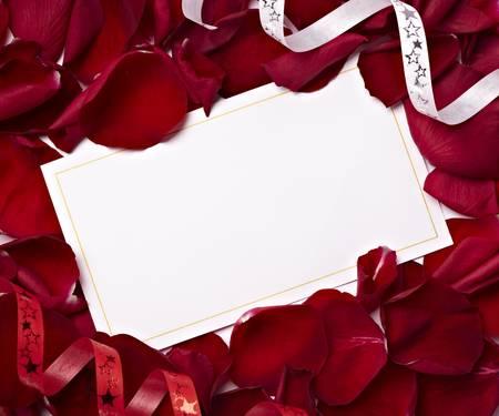 close up of greeting card dwith rose petals decoration photo