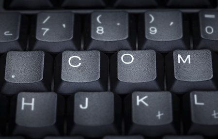 close up of word com on computer keyboard photo