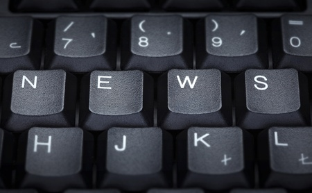 close up of word news on computer keyboard photo