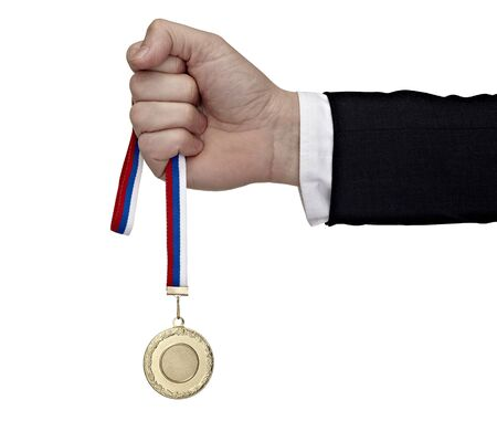 close up of a businessman hand holding golden medal on white background with clipping path Stock Photo - 8503174