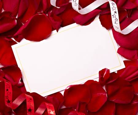close up of greeting card dwith rose petals decoration photo