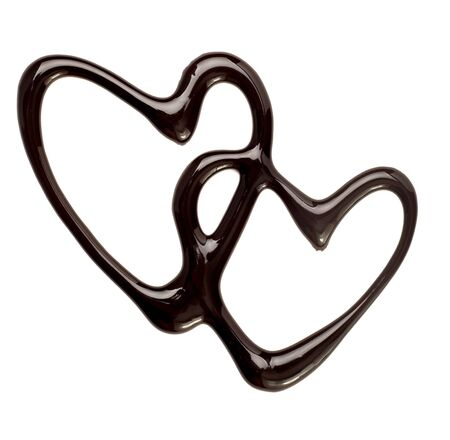 melting chocolate: close up chocolate syrup heart shape on white background