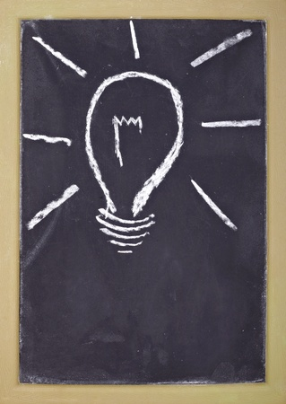 close up of light bulb drawing on chalkboard Stock Photo - 8619093