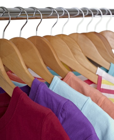 close up of t shirts on cloth hangers in row photo