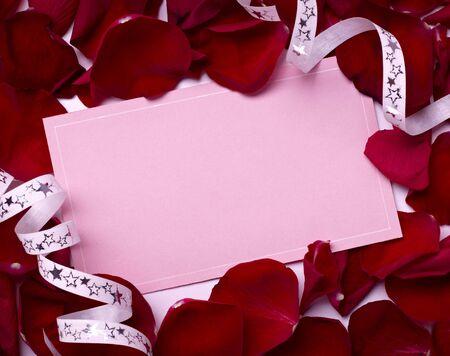 annotation: close up of greeting card dwith rose petals decoration Stock Photo