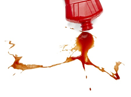 squirting ketchup: close up of  ketchup stains on white background  with clipping path