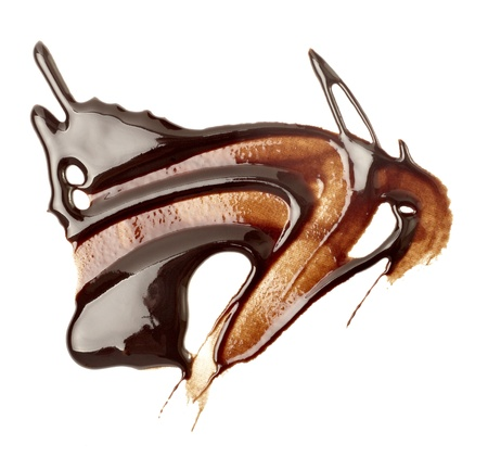 close up chocolate syrup stains on white background photo