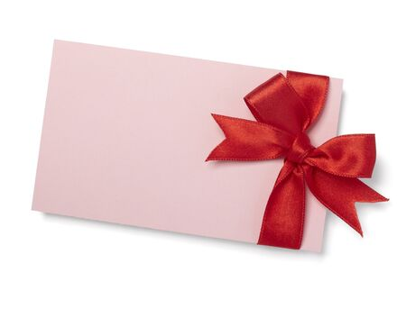 close up of  card note with red ribbon on white background  with clipping path photo