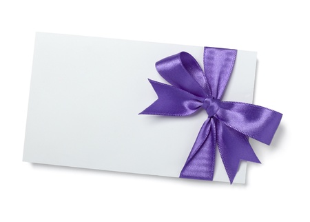 reminders: close up of  card note with  ribbon on white background
