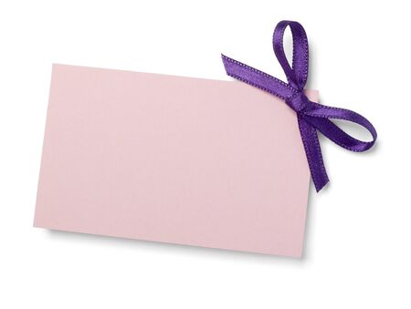 close up of  card note with  ribbon on white background  photo