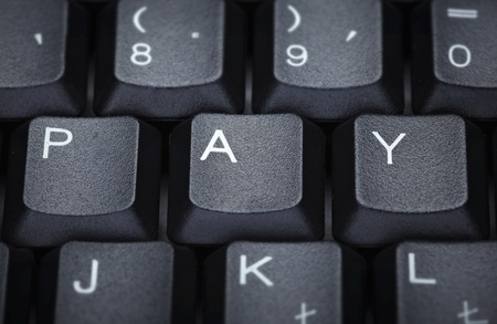 close up of word pay on computer keyboard photo