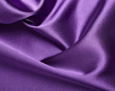 close up of purple silk textured cloth background