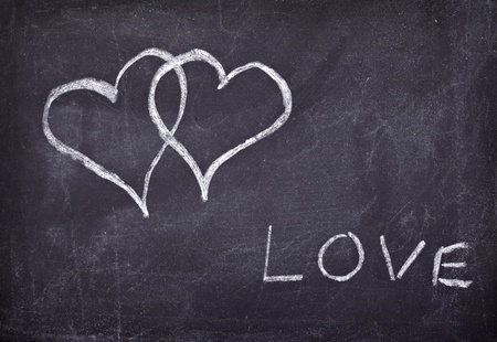 classroom chalkboard: love hearts drawing on a school chalkboard