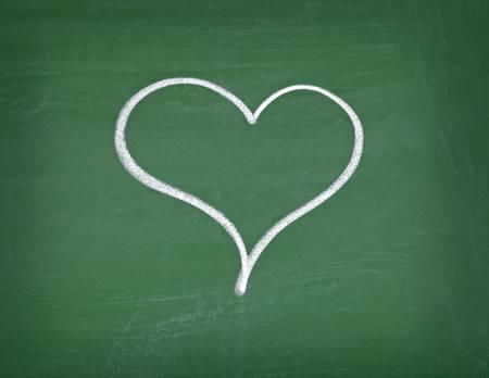 aprovechando una pizarra de la escuela de corazones de amor Foto de archivo - 8865202