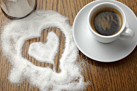 close up of a coffe cup and heart shape in sugar on table Stock Photo - 8865233