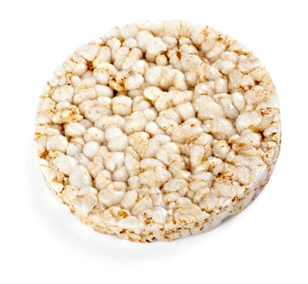 puffed: close up of a puffed rice snack on white background