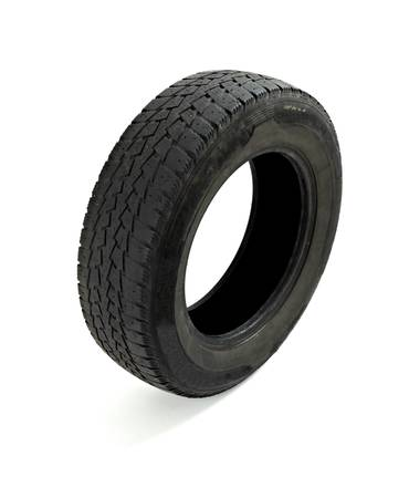 close up of a used car tire on white background  photo