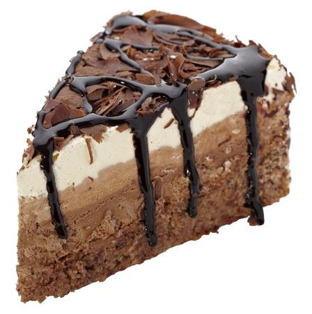 close up of a chocolate cream cake on white plate photo