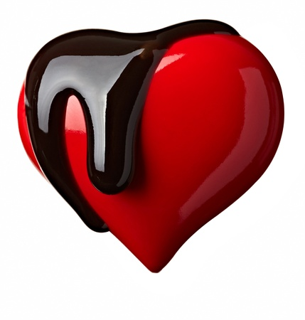 chocolate drop: close up chocolate syrup leaking over heart shape symbol on white background  Stock Photo