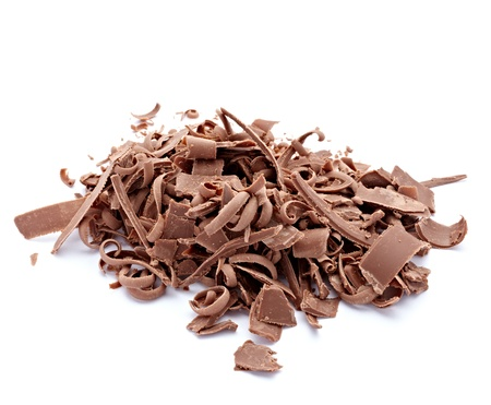 chocolate curls: close up  of chocolate pieces on white background