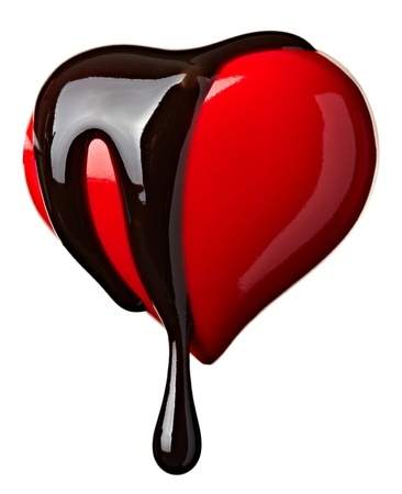melting chocolate: close up chocolate syrup leaking over heart shape symbol on white background with clipping path