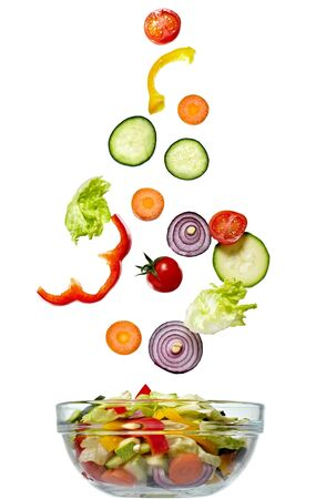 green salad: close up of vegetables on white background