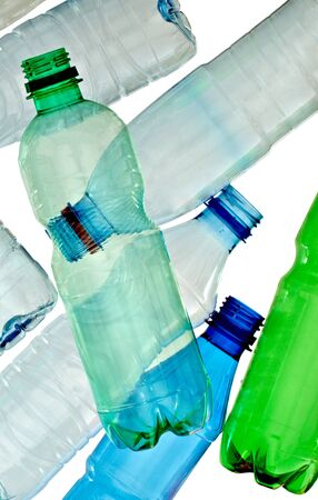 close up of empty used plastic bottles on white background with clipping path photo