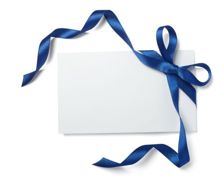 close up of  card note with blue ribbon on white background  with clipping path photo