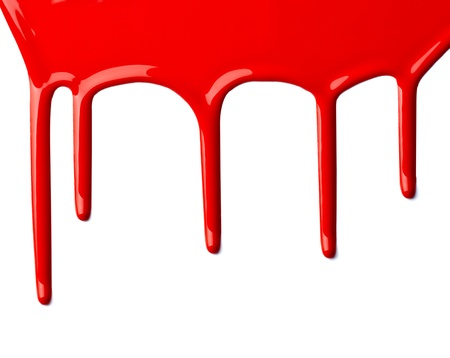 close up of red paint leaking on white background photo
