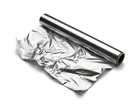 foil: Close up aa foglio di alluminio su sfondo bianco con un tracciato di ritaglio Archivio Fotografico
