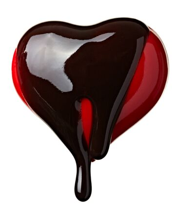 syrupy: close up chocolate syrup leaking over heart shape symbol on white background with clipping path