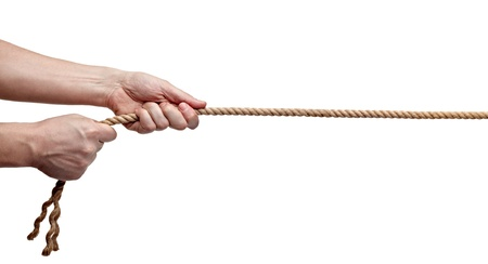 cordage: close up of hands pulling a rope on white background with clipping path