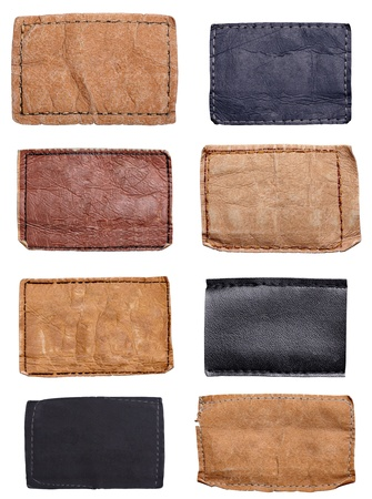 collection of various jeans labels on white background. each one is shot separately photo