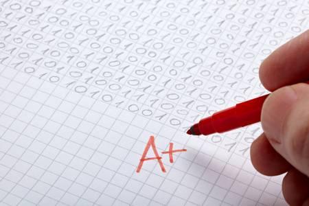 close up of grade a and math examination photo