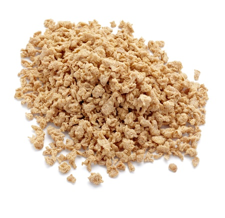 close up of soya flakes on white background with clipping path photo